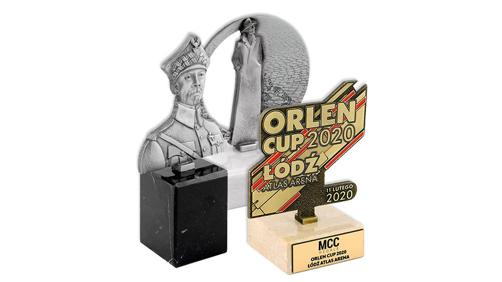 Statuetki i przypinki metalowe – wyjątkowe pamiątki okolicznościowe - Zdjęcie główne